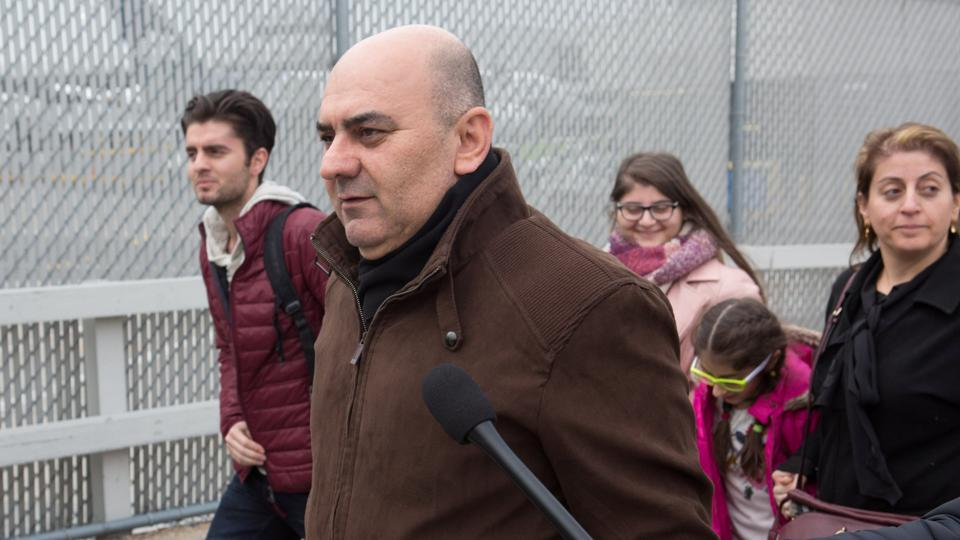 Fuad Sharef Suleman (C) and his wife and children arrive at Terminal 1 at JFK airport in Queens, New York City, New York, on Sunday. The Iraqi family were previously prevented from boarding a plane to the US following US President Donald Trump's decision to temporarily bar travellers from seven countries, including Iraq.