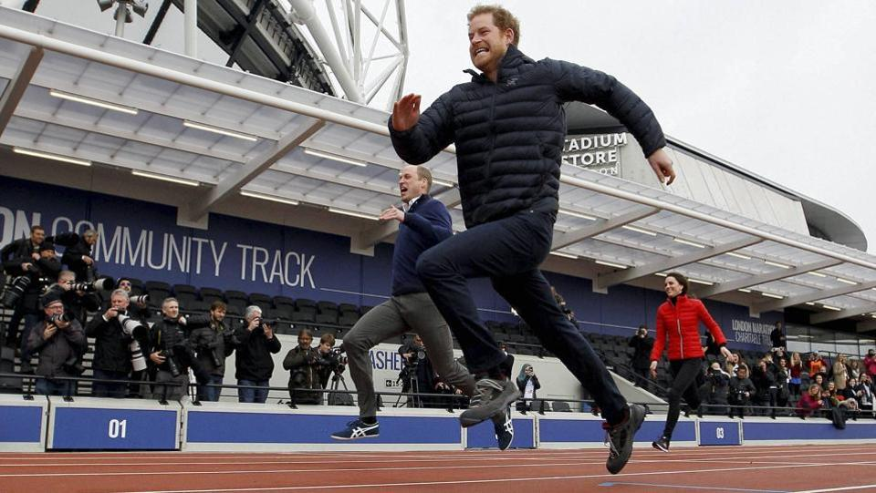 Prince Harry dashes past  Prince William and Kate, the Duchess of Cambridge in a relay race during the promotion of the charity Heads Together at the Queen Elizabeth II Park in London.  (AP)
