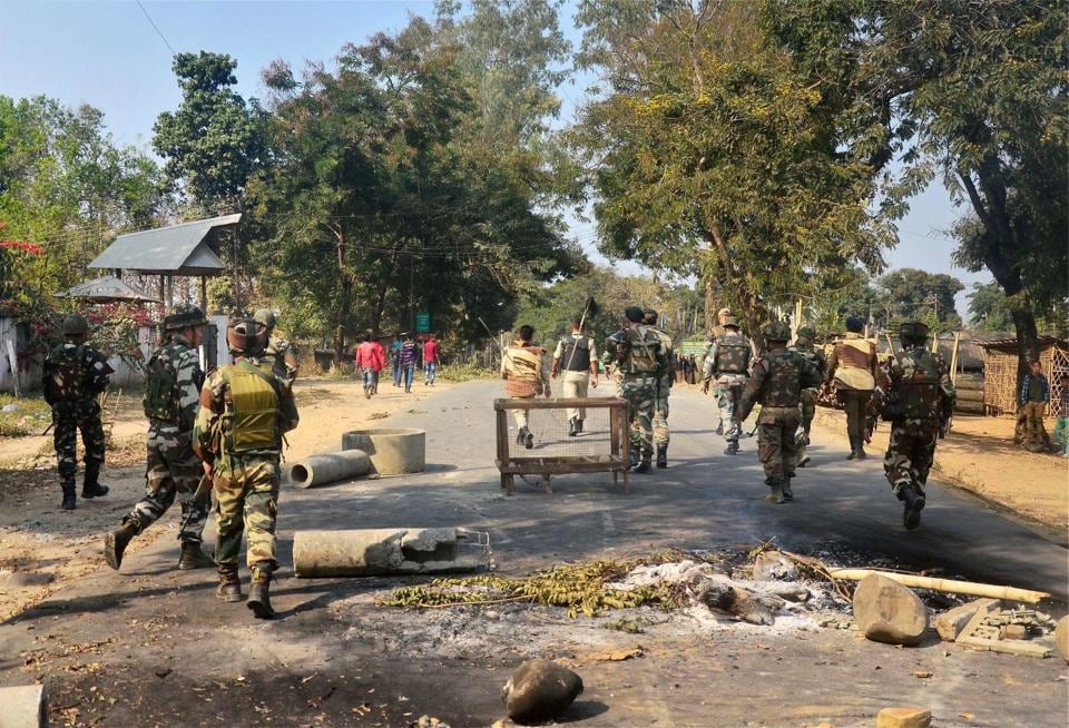 Security personnel patrol as bandh supporters block the highway during a strike call against 33% women's reservation and killing of two persons in police firing in Dimapur.