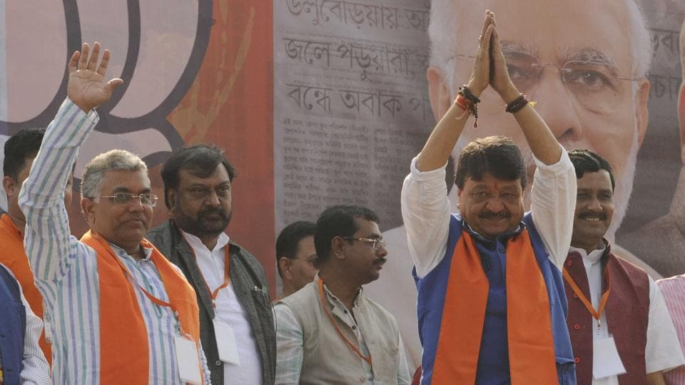 National General Secretary of BJP Kailash Vijayvargiya(2nd left) with party state President Dilip Ghosh(left) at Shahid Minar ground in Kolkata, India, on Monday.