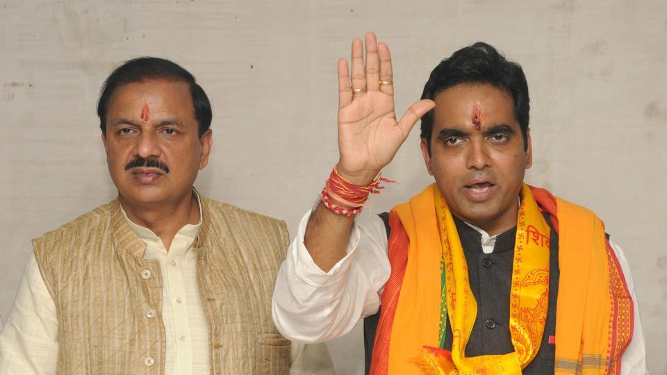 Home minister Rajnath Singh's son, Pankaj Singh, along with Union minister Mahesh Sharma (left) addresses party workers after filing his nomination papers for the Noida assembly seat.