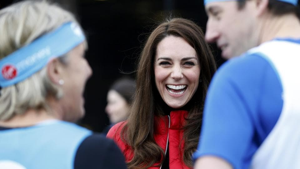 Kate, the Duchess of Cambridge, laughs as she prepares to take part in a relay race during the promotion of a charity Heads Together at the Queen Elizabeth II Park in London.  (REUTERS)
