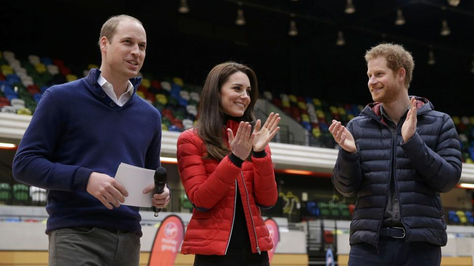 Kate, the Duchess of Cambridge, and Prince Harry (right) applaud Prince William after his speech during the promotion of the charity Heads Together at the Queen Elizabeth II Park in London.  (REUTERS)