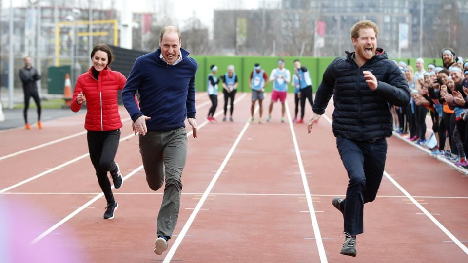 Prince William (second left), his wife Kate, the Duchess of Cambridge, and Prince Harry take part in a relay race during the promotion of a charity Heads Together at the Queen Elizabeth II Park in London.  (AP)