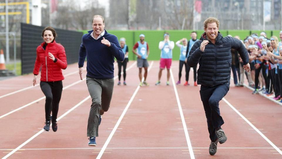 Britain's Prince William (second left), Kate, the Duchess of Cambridge (left), and Prince Harry take part in a race during the promotion of the charity Heads Together at the Queen Elizabeth II Park in London on Sunday.  (AP)