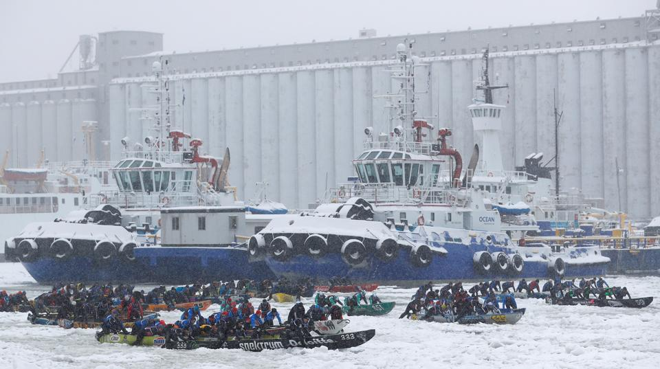 Canoers compete in the ice canoe race at the Quebec Winter Carnival in Quebec City.  (REUTERS)