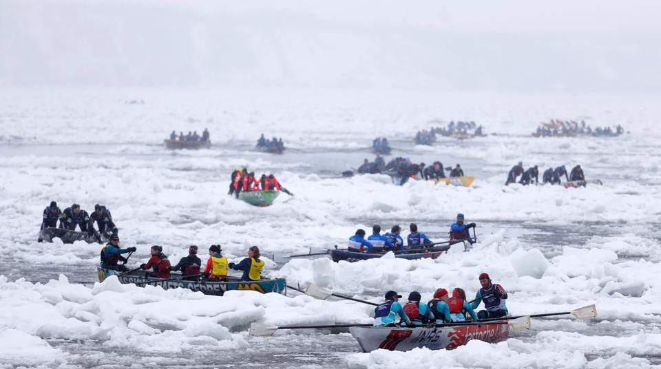 Canoers compete during the ice canoe race at the Quebec Winter Carnival in Quebec City.  (REUTERS)