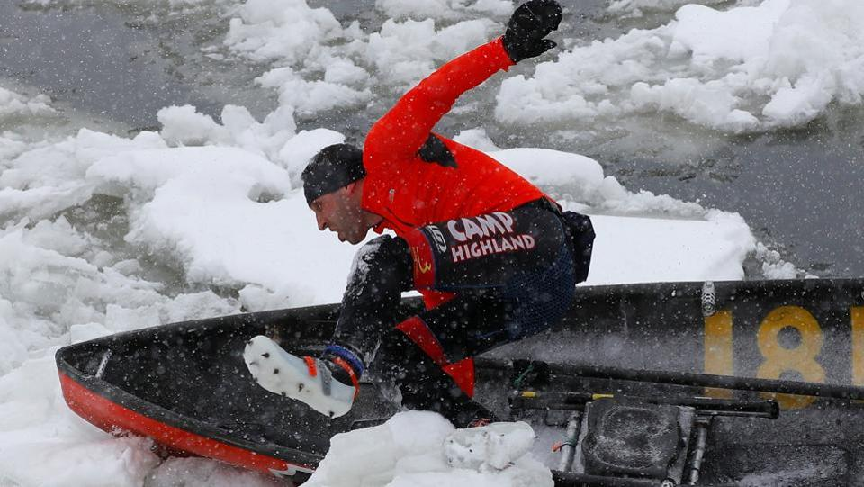 A canoer jumps over a block of ice during the ice canoe race at the Quebec Winter Carnival in Quebec City.  (REUTERS)