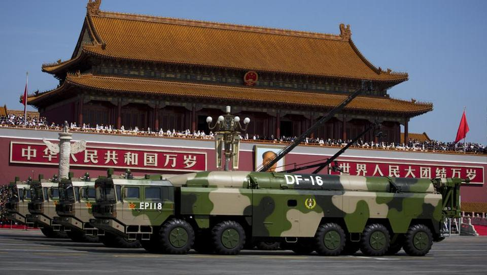 File photo from September 2015 shows vehicles carrying the DF-16 ballistic missiles past Tiananmen Gate during a military parade to commemorate the 70th anniversary of the end of World War II. The highly accurate ballistic missile capable of threatening US and Japanese bases in Asia made its latest appearance at recent Rocket Force drills. The DF-16 featured in a video posted on the defence ministry's website showed the missiles aboard their 10-wheeled mobile launch vehicles being deployed in deep forests during exercises over the just concluded Lunar New Year holiday.