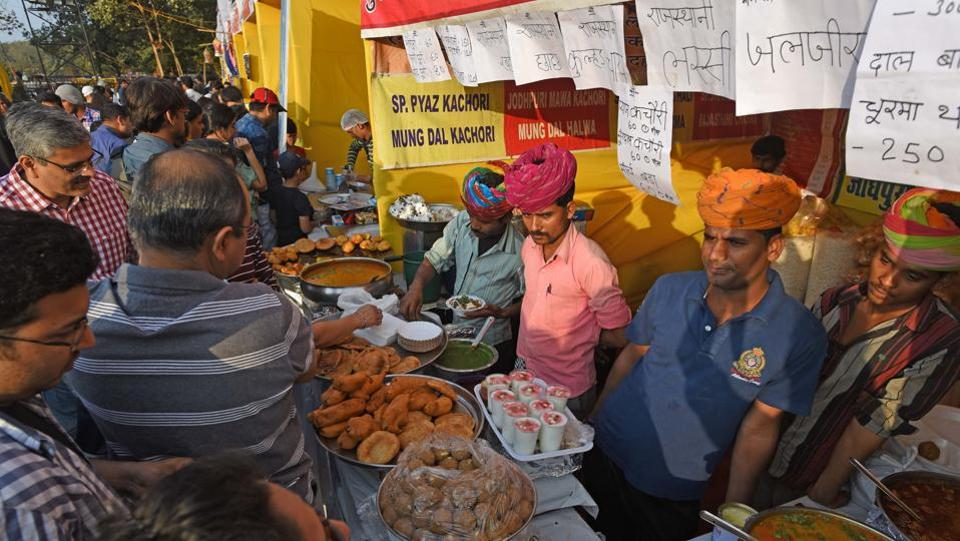 Hungry patrons dig into Rajasthani food at one of the many stalls dotting the landscape at the HT Kala Ghoda Arts Festival at Cross Maidan on Sunday. (Pratik Chorge/HT )