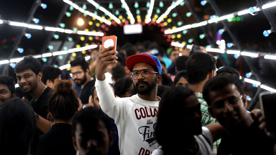 The crowd takes pictures inside an installation during the HTKala Ghoda Arts Festival at Cross Maidan on Sunday. (Pratik Chorge/HT )