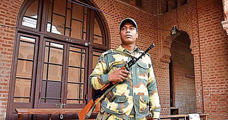 A paramilitary soldier on duty outside a room where EVMs are stored, at Khalsa College, in Amritsar.