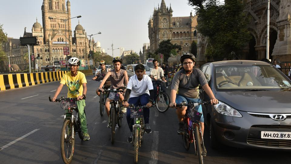 Young cyclists make their way through the historic Fort area as part of a heritage tour on Sunday. (Arijit Sen/HT )
