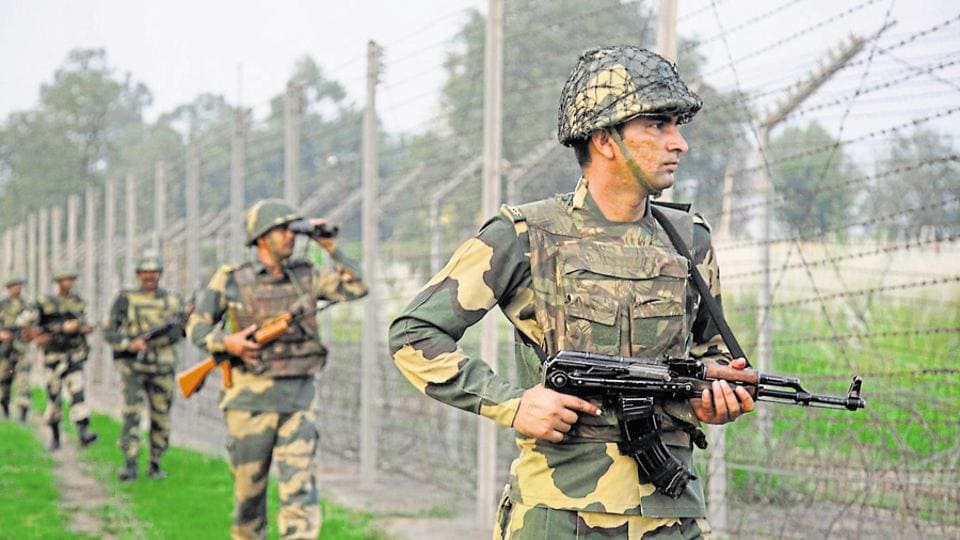 Border security force soldiers patrol near the India-Pakistan international border area.