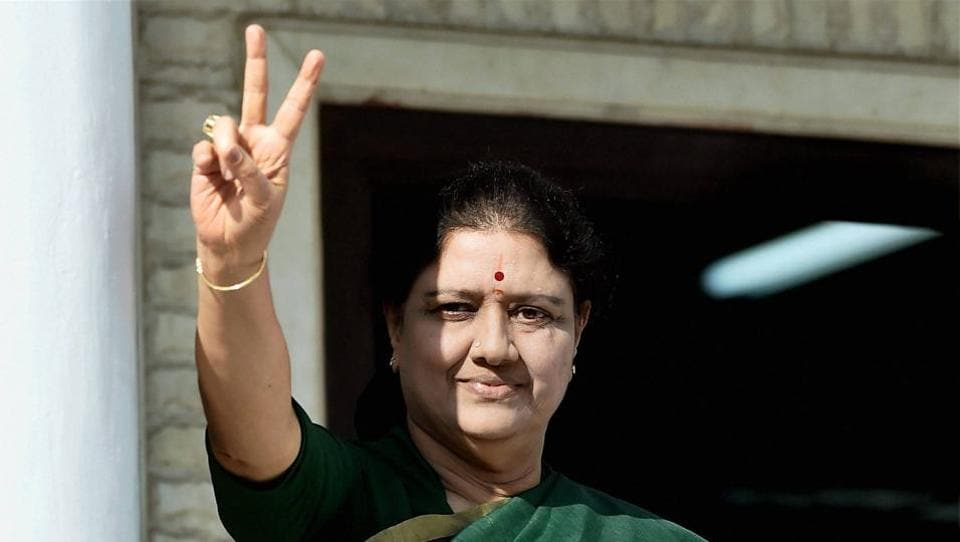 AIADMK general secretary V K Sasikala flashes a victory sign after attending a meeting of the MLAs  of the party that elected her as the legislative party leader, at AIADMK headquarters in Chennai on Sunday.
