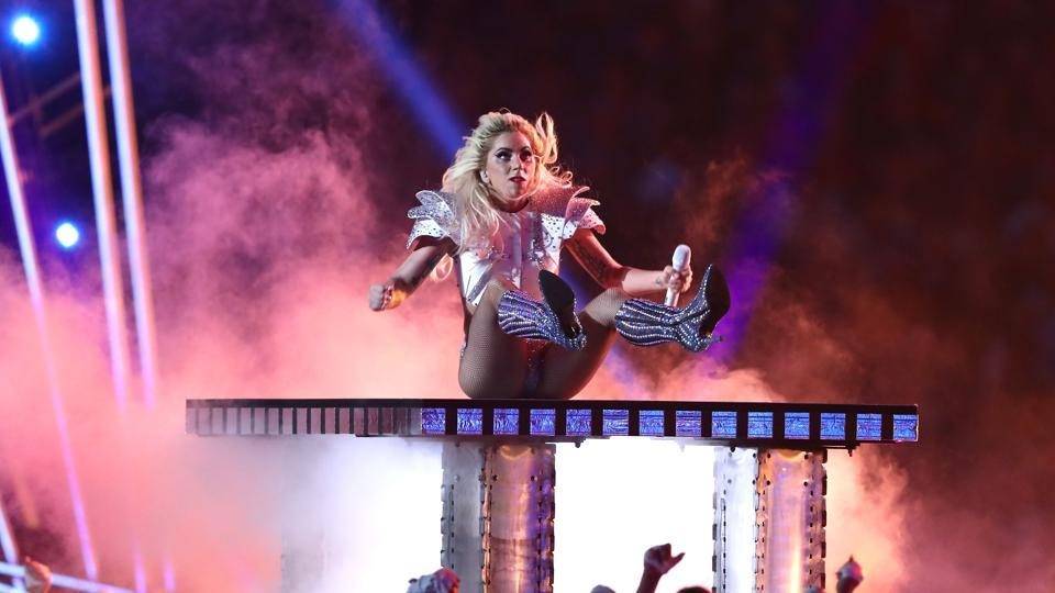 The finale Bad Romance was a crowd pleaser. Gaga, who had spent much of the evening in a metallic space suit, emerged in her third outfit of the performance, a midriff baring costume topped off by football-like shoulder pads. (AFP)