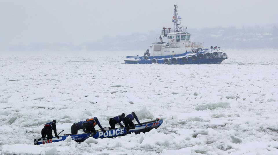 Team Police de Quebec compete in the ice canoe race at the Quebec Winter Carnival in Quebec City.  (REUTERS)