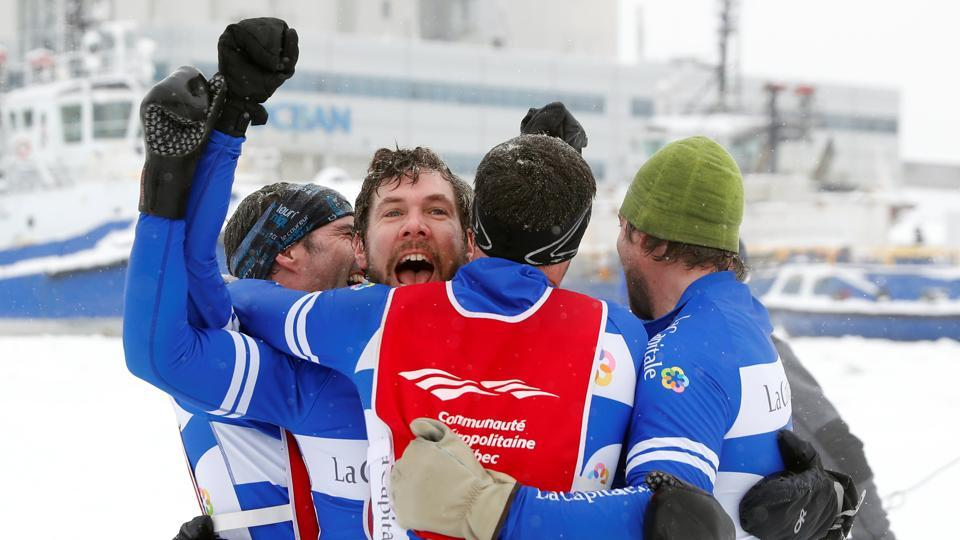Team La Capitale celebrates after winning the men's elite division ice canoe race at the Quebec Winter Carnival in Quebec City.  (REUTERS)