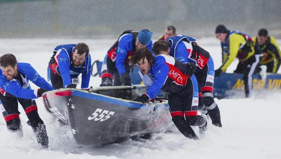 Team Amiral/Pharmacie Marie-Pier Labbe Inc. takes part in the ice canoe race on the Saint Lawrence river as part of the Quebec Winter Carnival in Quebec on Sunday. (AP)