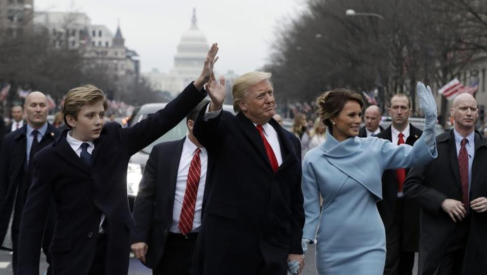 President Donald Trump waves as he walks with first lady Melania Trump and their son Barron during the inauguration parade on January 20. Ten-year-old Barron has recently become the target of mean comments and tweets.