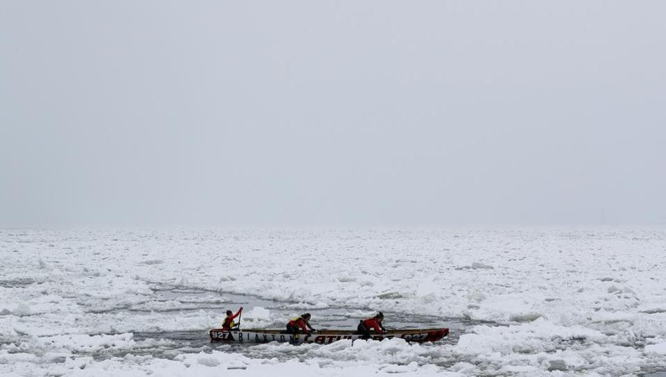 Team Latulipe competes in the ice canoe race at the Quebec Winter Carnival in Quebec City.  (REUTERS)