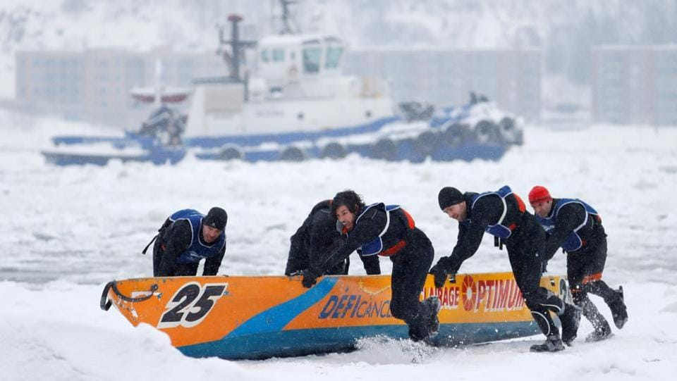 Team Optimum competes in the ice canoe race at the Quebec Winter Carnival in Quebec City.  (REUTERS)