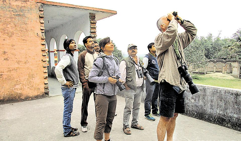 Two Czech tourists at the breeding site of greater adjutants at Kadwa diara in Bhagalpur district of Bihar.