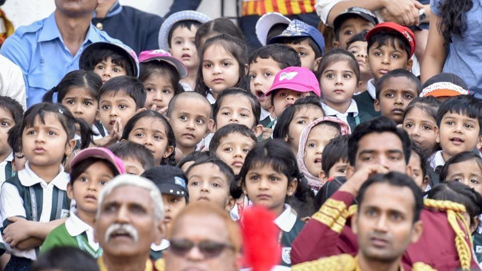 Schoolchildren watch as the firemen perform the Angus Ladder drill. (Kunal Patil/Ht photo)