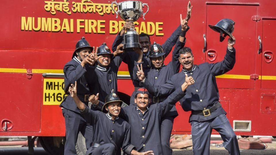 The Andheri fire unit celebrate their win in the competition. (Kunal Patil/Ht photo)