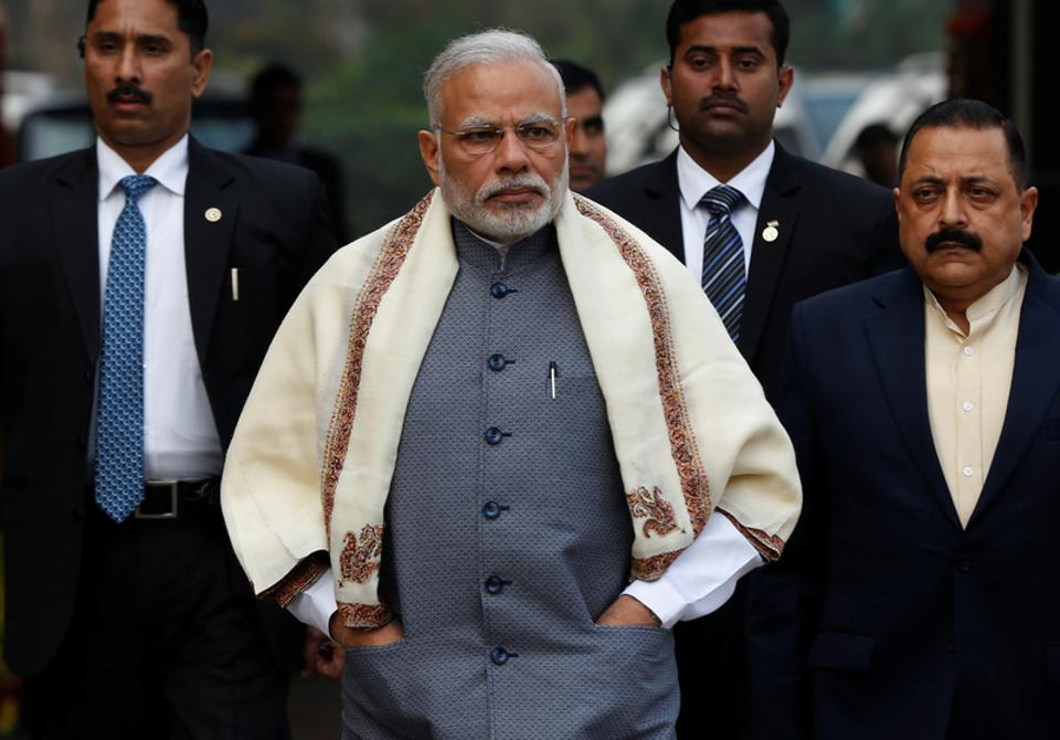 Prime Minister Narendra Modi walks to speak with the media as he arrives at the parliament house to attend the first day of the budget session.