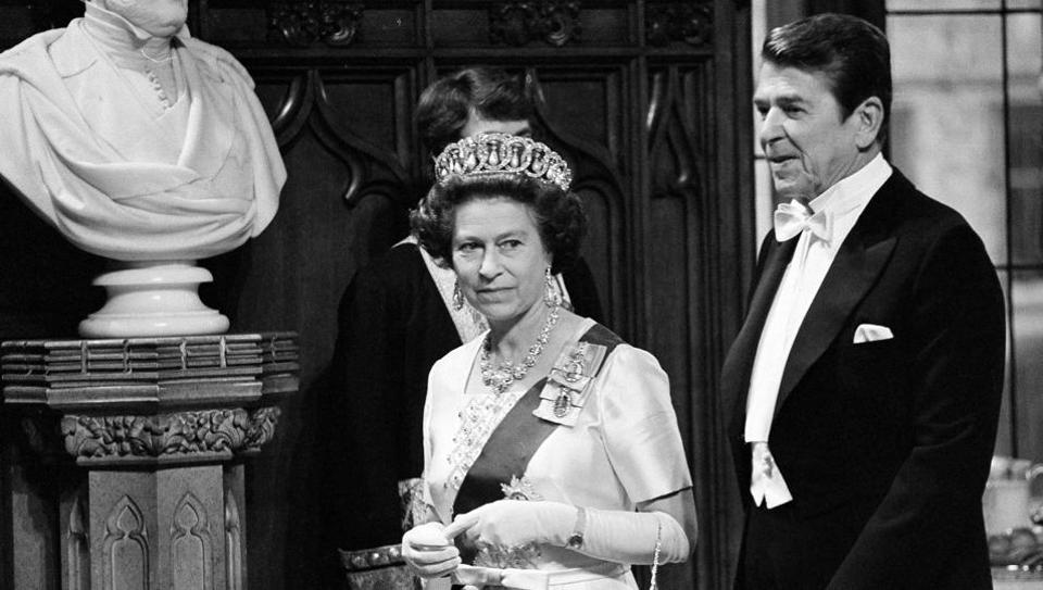 In this June 8, 1980 file photo, Britain's Queen Elizabeth II and U.S. President Ronald Reagan walk into St. George's Hall at Windsor Castle, England. On Monday Feb. 6, 2017. (AP File Photo)