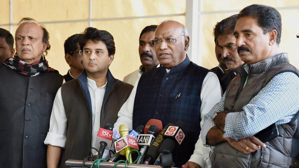 Congress MPs Mallikarjun Kharge addressing media as Jyotiraditya Scindia along with other members look on during the budget session at Parliament house in New Delhi on Friday.