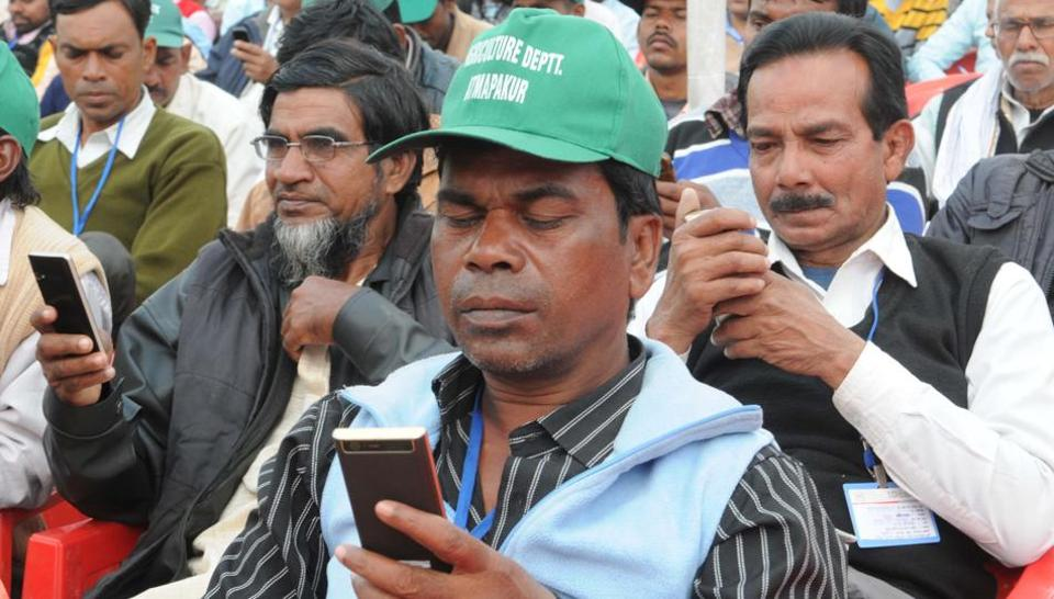 Farmers learning cashless trading through cell phones during the farmers conclave organised by state government to promote cashless banking in Ranchi. The Supreme Court feels verification was necessary in view of the fact that mobile phones are now used for banking.