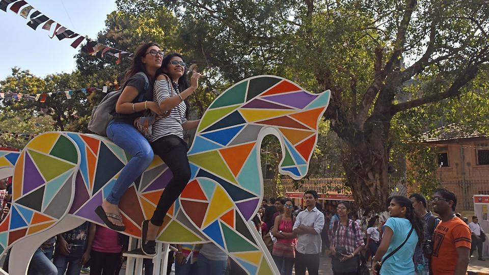 Youngsters  pose on one of the installations at the festival. (Pratham Gokhale/HT PHOTO)