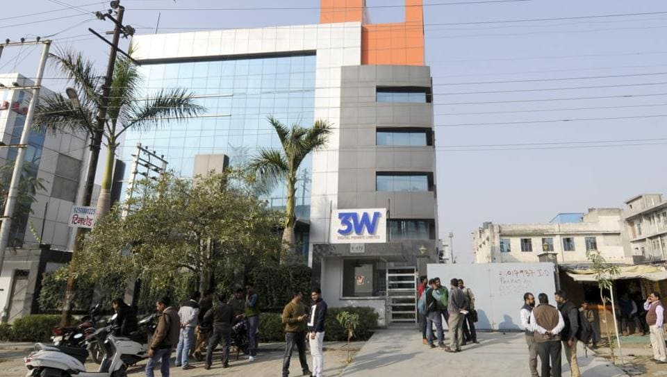 People outside Ablaze Info Solutions' office in Noida Sector 63.