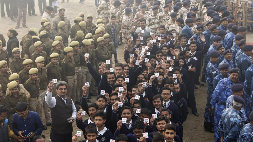 Students hold up badges urging people to cast their votes, during an election awareness campaign in Uttar Pradesh. Elections in northern Uttar Pradesh begin on February 11.