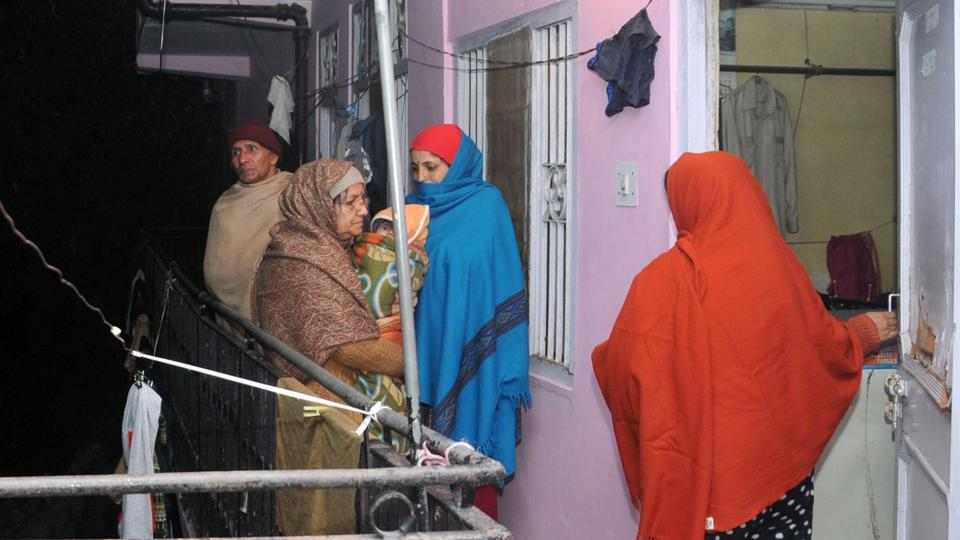 Residents come out from their houses after the earthquake in the northern hill town of Shimla.