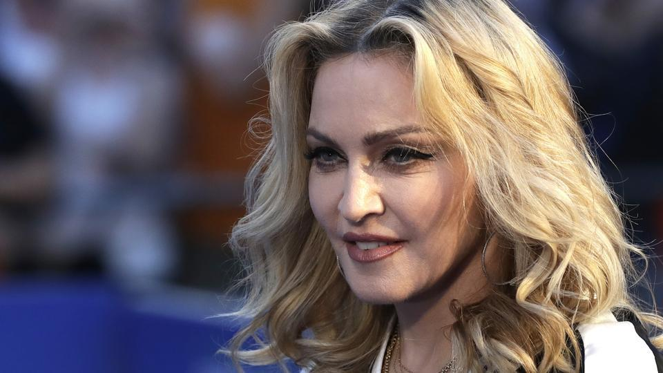 Madonna poses for photographers upon arrival at the World premiere of the film The Beatles, Eight Days a Week in London.