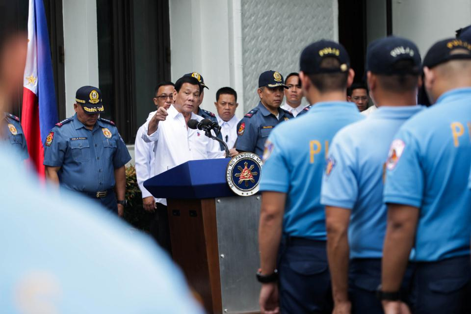 Philippine President Rodrigo Duterte talks to police officers who are under investigation for various infractions during a meeting at the Malacanang presidential palace in Manila on Tuesday.