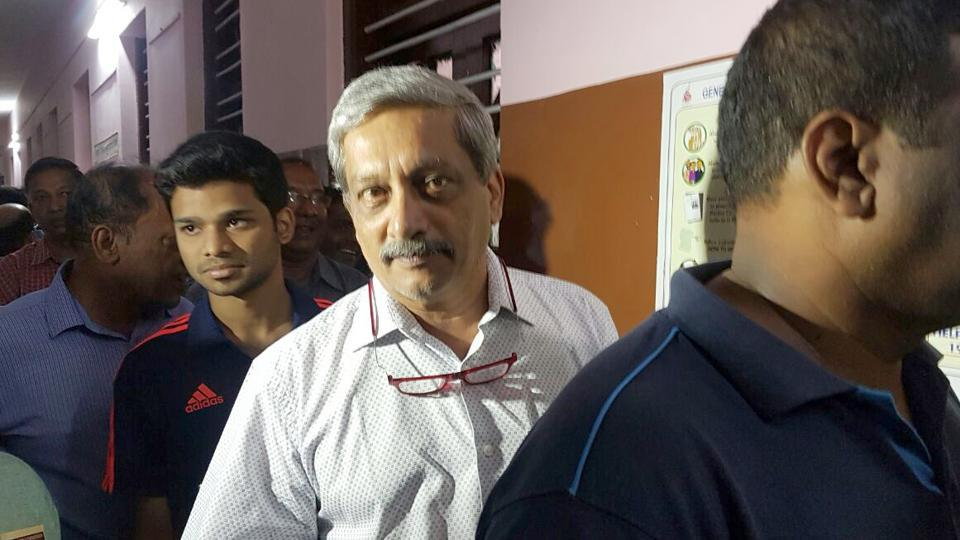 Defence minister Manohar Parrikar stands in queue to cast his vote during the Goa assembly election at a polling booth in Panaji on February 4.
