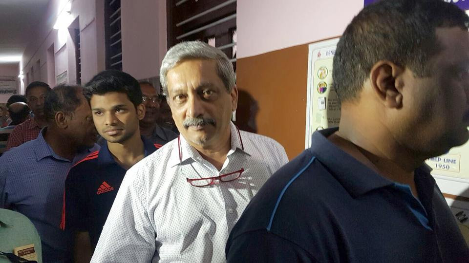 Defense Minister Manohar Parrikar in a queue to cast his vote for Assembly State election at polling booth in Panaji on Saturday.
