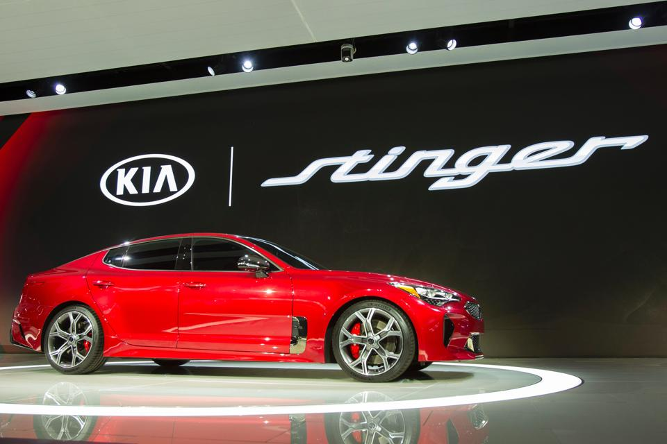 The Kia Stinger is unveiled during a press conference at the 2017 North American International Auto Show in Detroit, Michigan, January 9, 2017. / AFP PHOTO / Geoff Robins