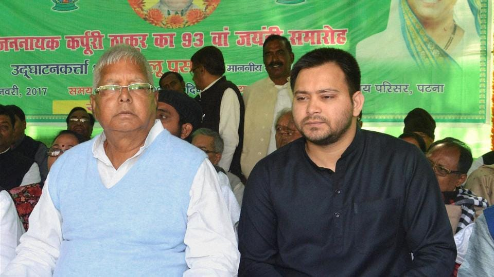 RJD chief Lalu Prasad with his son, Bihar deputy CM Tejashwi Yadav at an event in Patna.