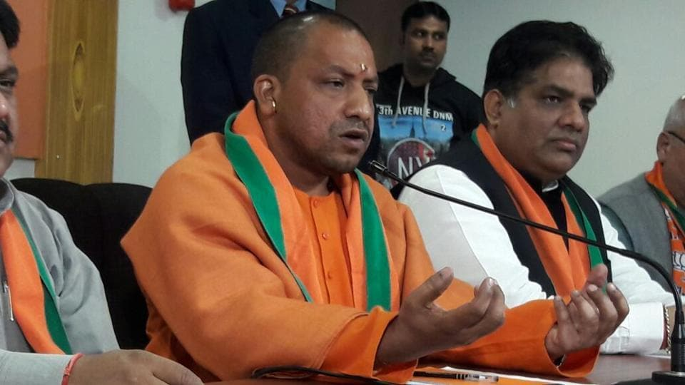 BJP leader Yogi Adityanath addresses the media in Lucknow.