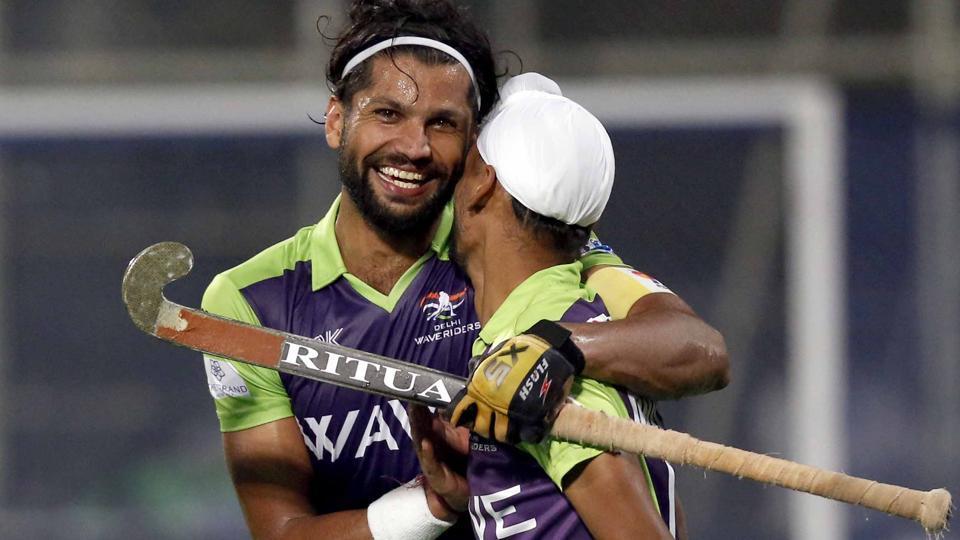 Mandeep Singh (right) and Delhi Waveriders skipper Rupinderpal Singh celebrate a goal against Uttar Pradesh Wizards during their Hockey India League (HIL)match in New Delhi onWednesday.