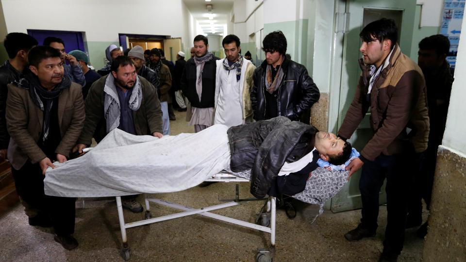 Men carry an injured man to a hospital after a bomb blast in Kabul, Afghanistan February 7, 2017. REUTERS/Mohammad Ismail