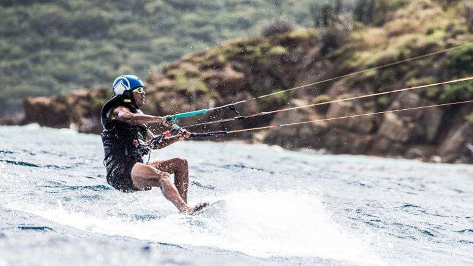 Former US president Barack Obama is pictured during a kitesurfing session with British billionaire Richard Branson, off the coast of Moskito Island in the British Virgin Islands in the Caribbean.