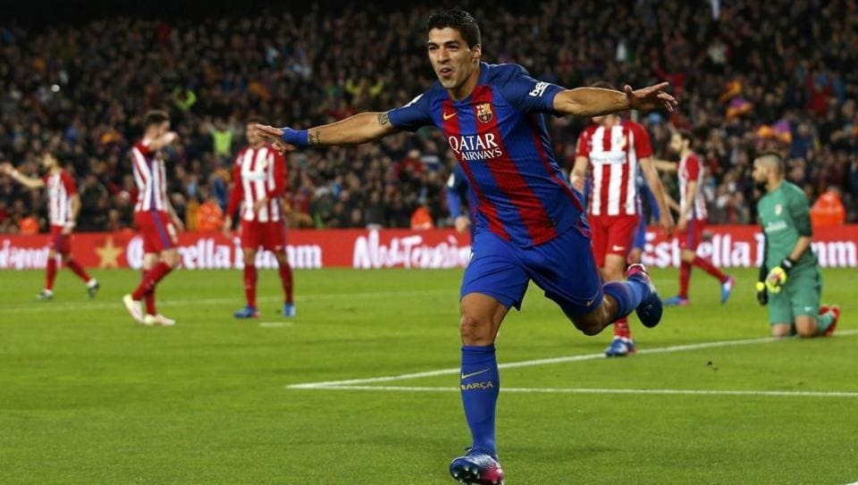 Barcelona's Luis Suarez celebrates after scoring the first goal against Atletico Madrid in their Spanish King's Cup second leg semi-final on Tuesday.