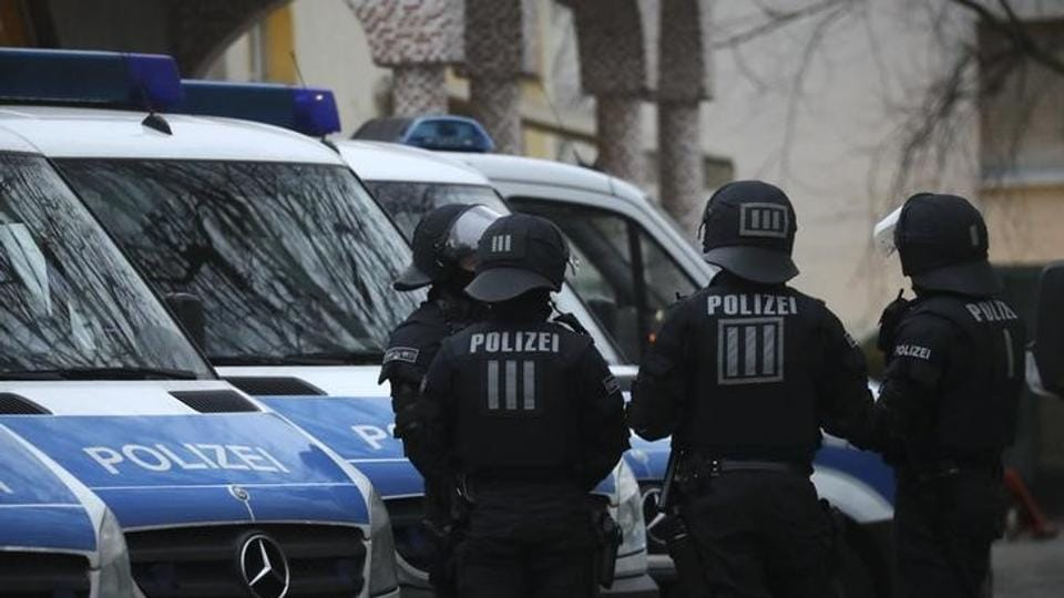 German special police forces stand guard in front of Frankfurt's Bilal mosque during early morning raids in the federal state of Hesse and its capital Frankfurt, Germany, on February 1, 2017.