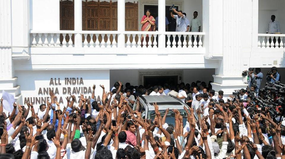 Secretary of the AIADMK party, VK Sasikala, gestures to supporters at the party headquaters in Chennai on Wednesday.